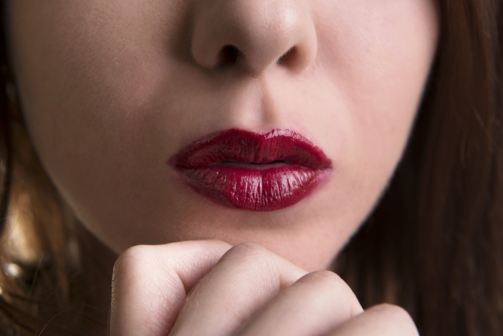 Close-up Of Woman With Beautiful Red Lips